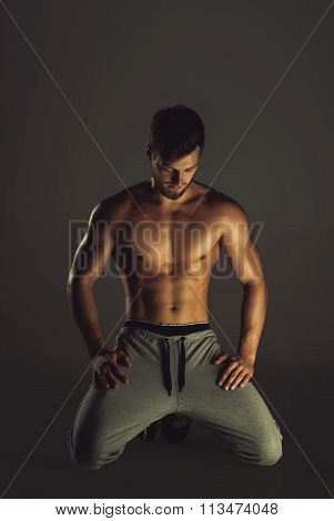 Athletic Handsome Young Man Posing In A Studio