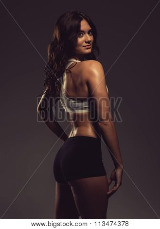 Beautiful Young Athletic Woman Posing In A Studio