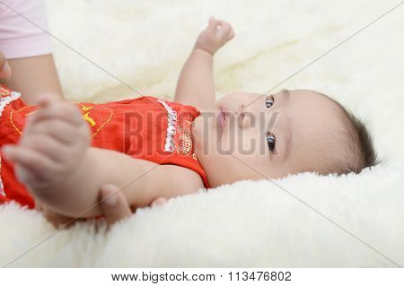 Baby Wearing A Red Dress Will Celebrate The Chinese New Year.