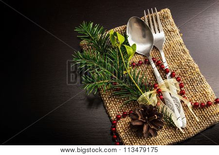 Christmas Silverware At Dark Wooden Table