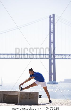 Man exercising at Lisbon, next to the river
