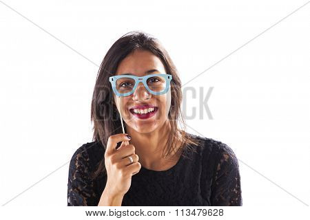 Woman peeking with funny paper glasses