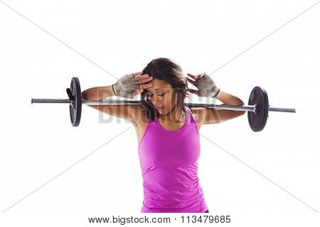 Woman exercising with a barbell weight isolated on white