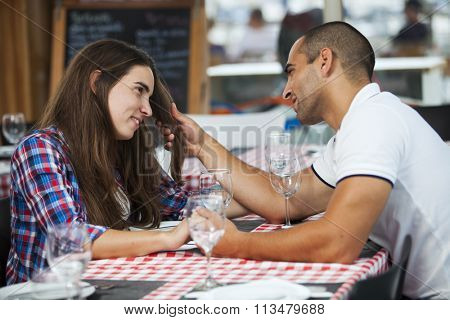 Couple enjoying their love at the restaurant