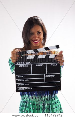 Happy woman holding a movie clapper