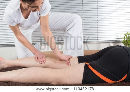 Macro Close Up Of Osteopathic Hamstring Massage.