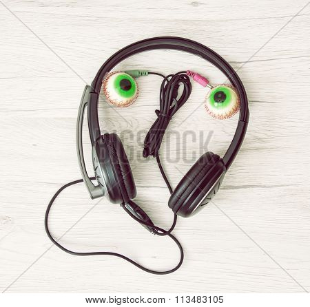 Smiling Face Of Headphones And Chewing Gums