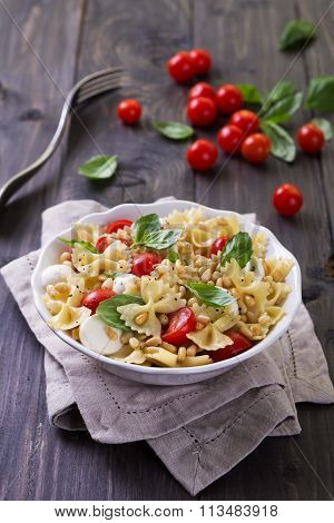 Pasta Salad With Tomato, Mozzarella, Pine Nuts And Basil