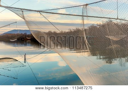 Fishing Net On The River Bojana, Montenegro With Clouds Reflection