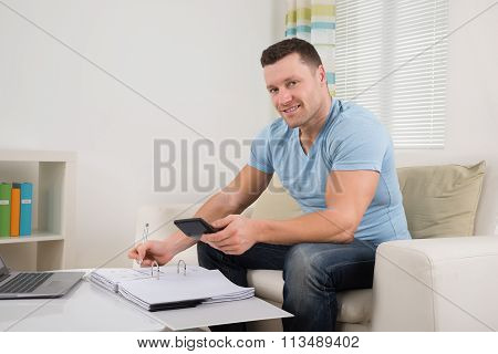 Man Calculating Budget At Home