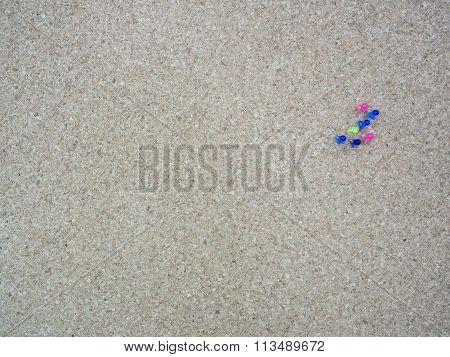 Group Of Thumbtacks Pinned On Cork Board (bulletin Board)