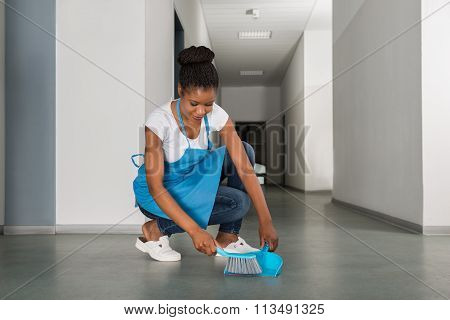 Woman Sweeping Floor With Whisk Broom