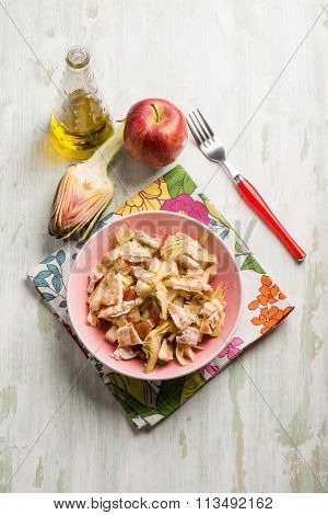 chicken salad with sliced apple and artichoke