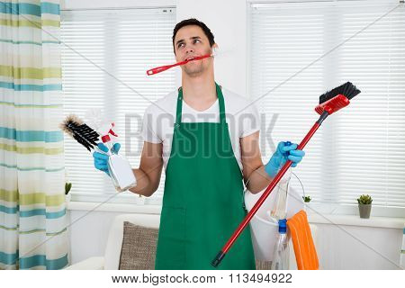 Overburdened Cleaner Holding Cleaning Equipment