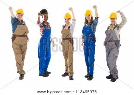 Portrait Of Successful Female Carpenters Standing In Row