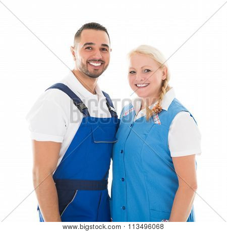 Portrait Of Happy Male And Female Janitors
