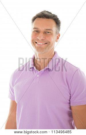 Portrait Of Happy Mature Man In Purple Tshirt