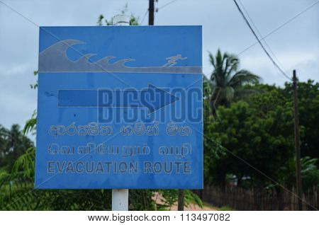 Blue sign for evacuation route
