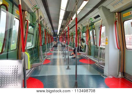 HONG KONG - MAY 06, 2015: interior of MTR train. The Mass Transit Railway is the rapid transit railway system in Hong Kong. It is one of the most profitable systems in the world