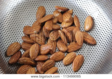 Fresh Shelled Almonds In A Colander