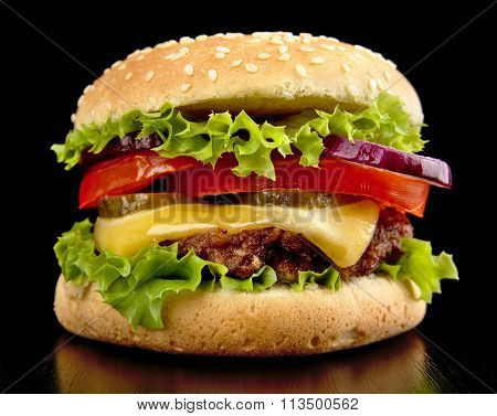 Big Cheeseburger Isolated On Black Background