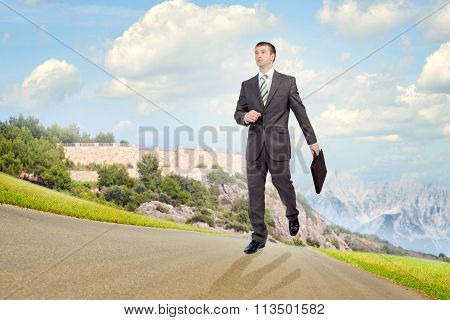 Young businessman walking forward
