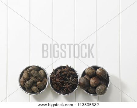 top view three bowl of spices malva nut,anise and nutmeg