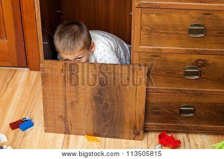 Little Boy Is Hiding In The Cupboard