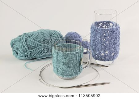 Knitted Coats For Mugs And Glasses With Clews