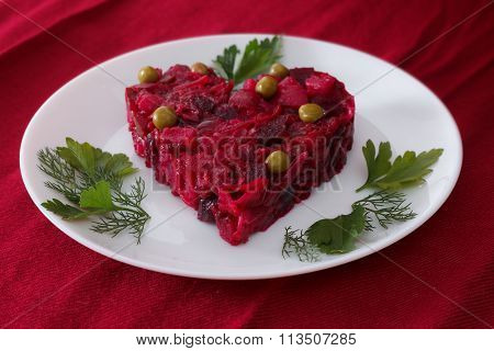 Beetroot And Vegetables Salad Made In Hearth Shape Served With Herbs On Plate