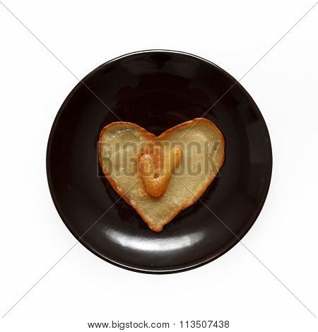 Heart Shaped Pancake With Letter V Inside On Dark Brown Plate Isolated On White Background