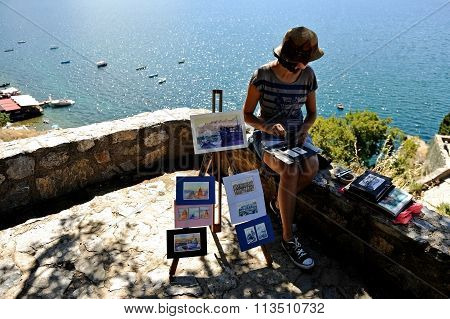 Painter With Works On The Shore Of Lake Ohrid In Macedonia