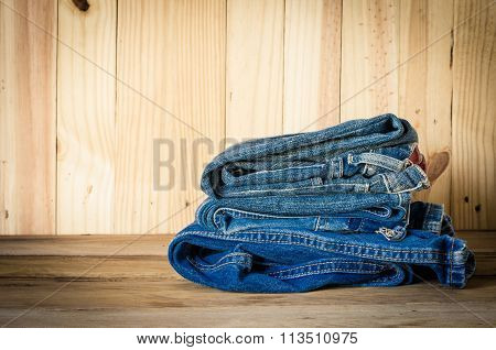 Travel Accessories Jeans On Wooden Backgrond