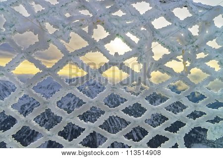 Fencing Mesh Being Frozen In Mountains In Wintertime