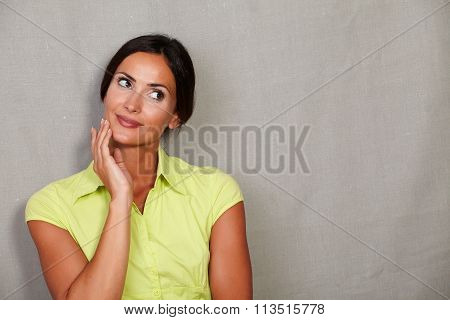 Pensive Lady Planning With Fingers On Face