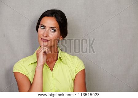 Long Hair Female Thinking With Hand On Chin