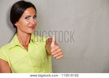 Happy Adult Female With Thumb Up And Smiling