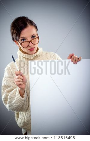 Serious Attractive Woman Holding A Blank Sign