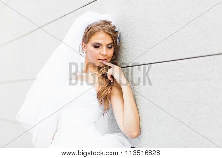 Portrait of  young bride in  white dress