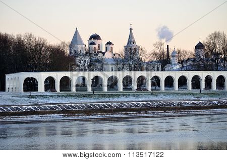 Arcade If Ancient Trades And Churches Of Yaroslav's Courtyard At Winter Sunset, Veliky Novgorod,