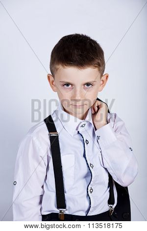 Stubborn sad upset little boychild isolated over yellow background.Facial expression
