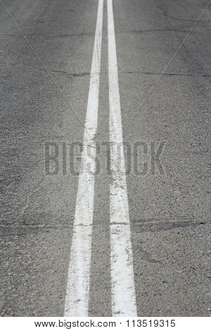 Asphalt Highway With Two White Stripes