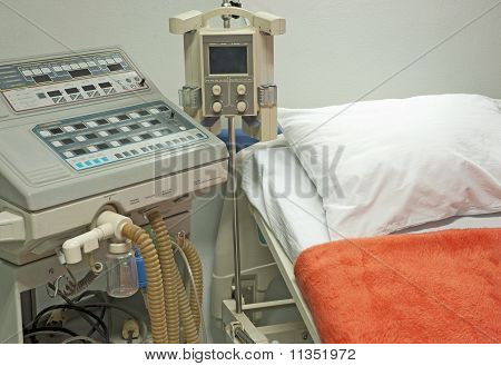 Ventilator Next To A Hospital Bed