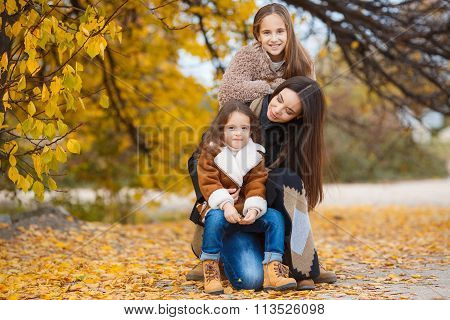 Family portrait in yellow autumn park