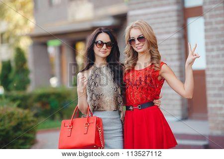 Two beautiful young women having fun in the city.