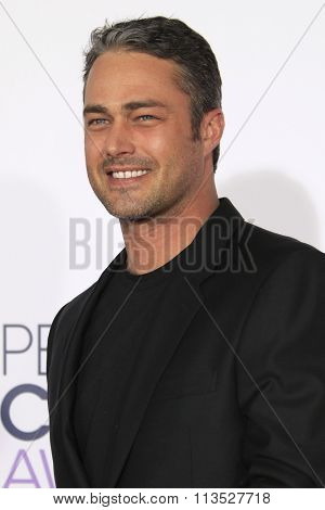 LOS ANGELES - JAN 6:  Taylor Kinney at the Peoples Choice Awards 2016 - Arrivals at the Microsoft Theatre L.A. Live on January 6, 2016 in Los Angeles, CA