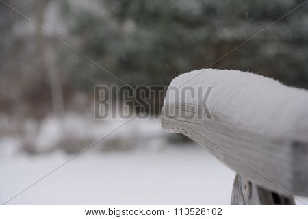 Old Wooden Chair Armrest In Snow