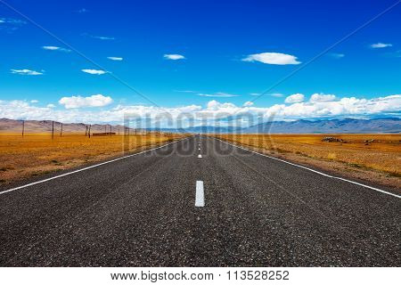 Road And Blue Cloudy Sky