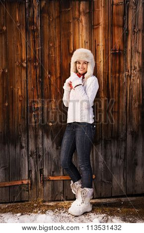 Full Length Portrait Of Woman With Red Cup Near Rustic Wood Wall
