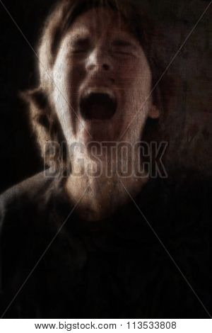 Screaming woman grunge blurred image